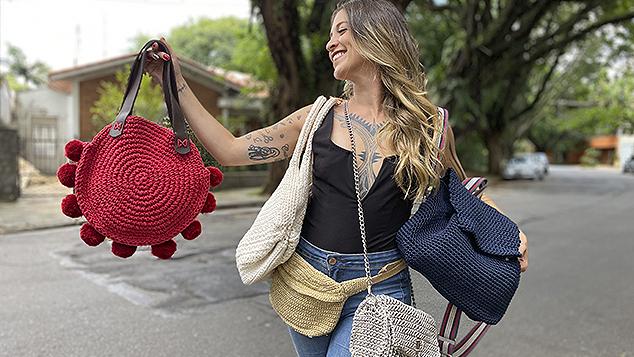 Anne Galante com bolsas